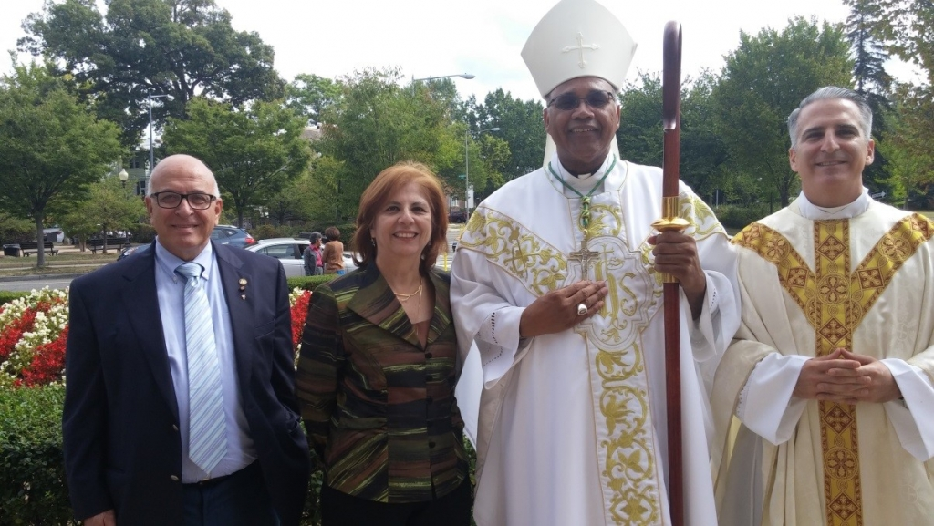 Sir Rateb Rabie and Lady Rocio Rabie with H.E. Bishop Martin D. Holley of the Archdiocese of Washington and Reverend Avelino Gonzalez, Pastor of St. Gabriel Catholic Church.