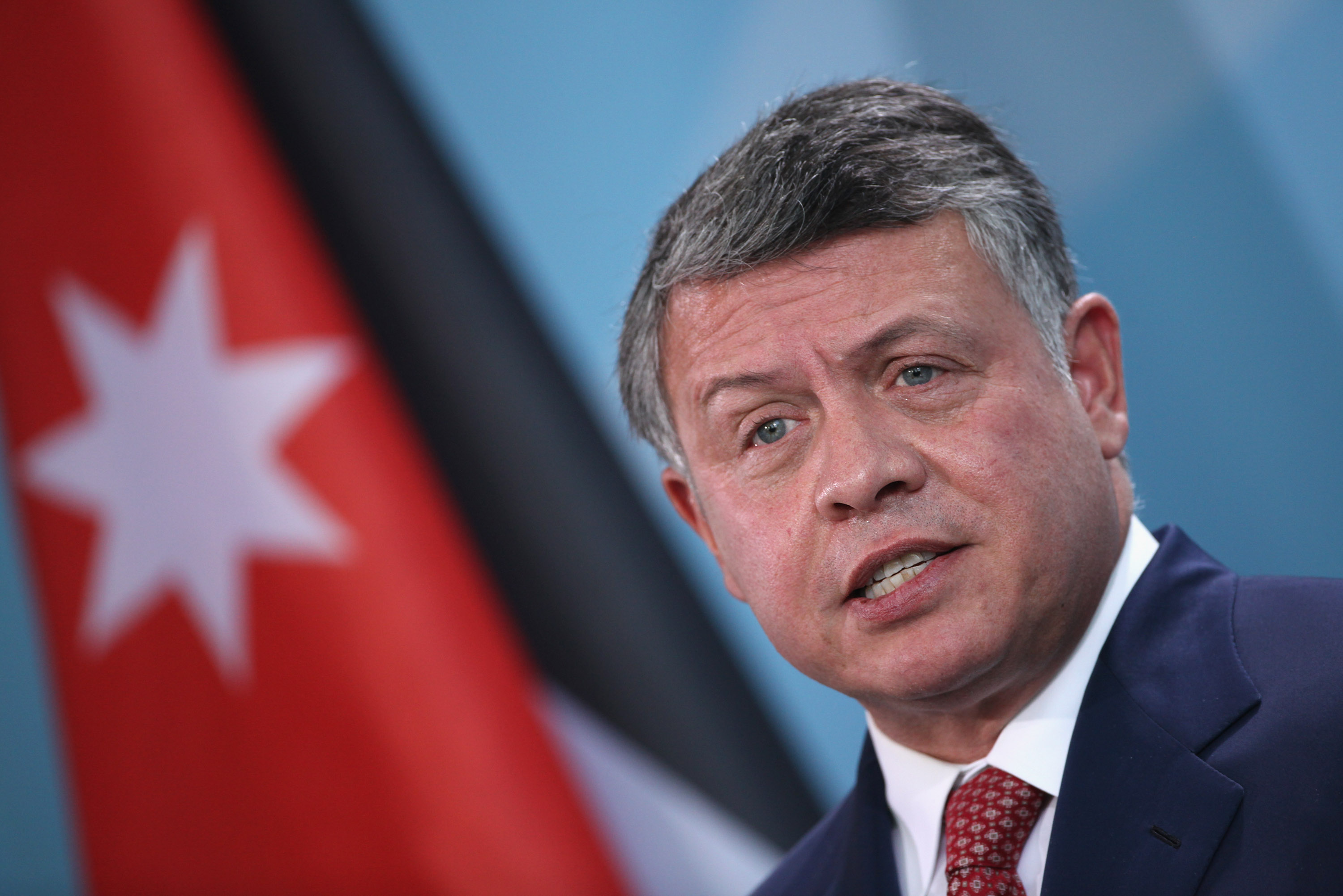 BERLIN, GERMANY - NOVEMBER 29:  King Abdullah II of Jordanspeaks to the media following talks with German Chancellor Angela Merkel at the Chancellery on November 29, 2011 in Berlin, Germany. The two leaders discussed, among other topics, the current situation in Syria.  (Photo by Sean Gallup/Getty Images)
