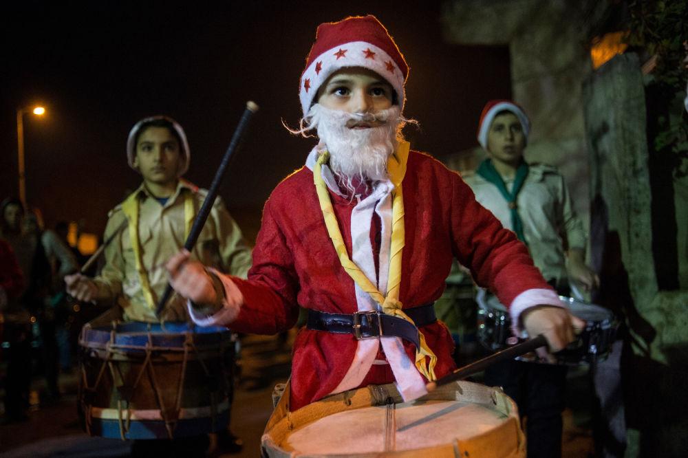Costumed children take part in Christmas festivities in Damascus.