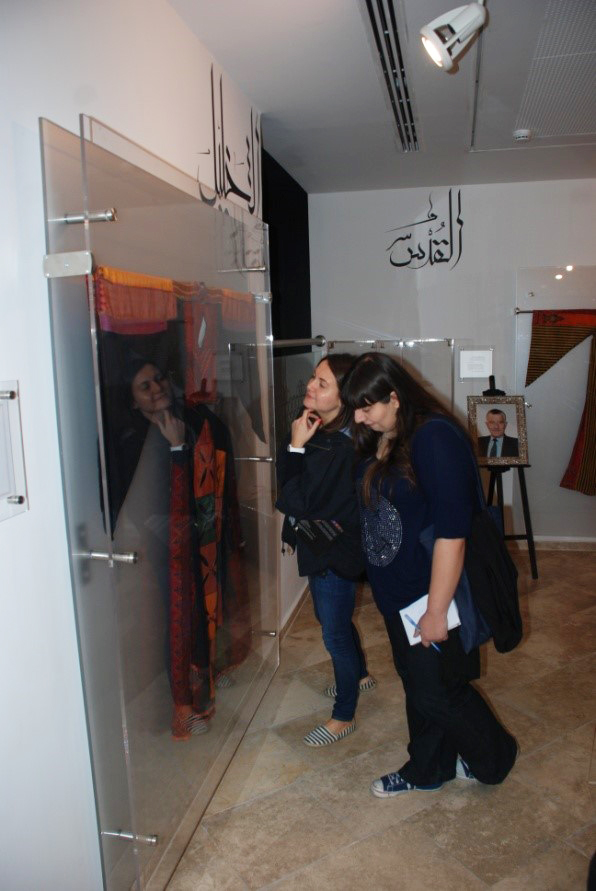 The representatives observing a traditional dress from Hebron– November26th, 2015
