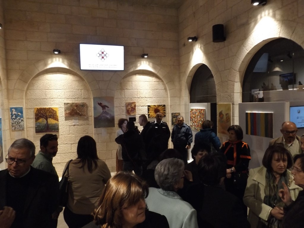 Guests view paintings by Palestinian artist, Saheer Jaouni – March 5th, 2016