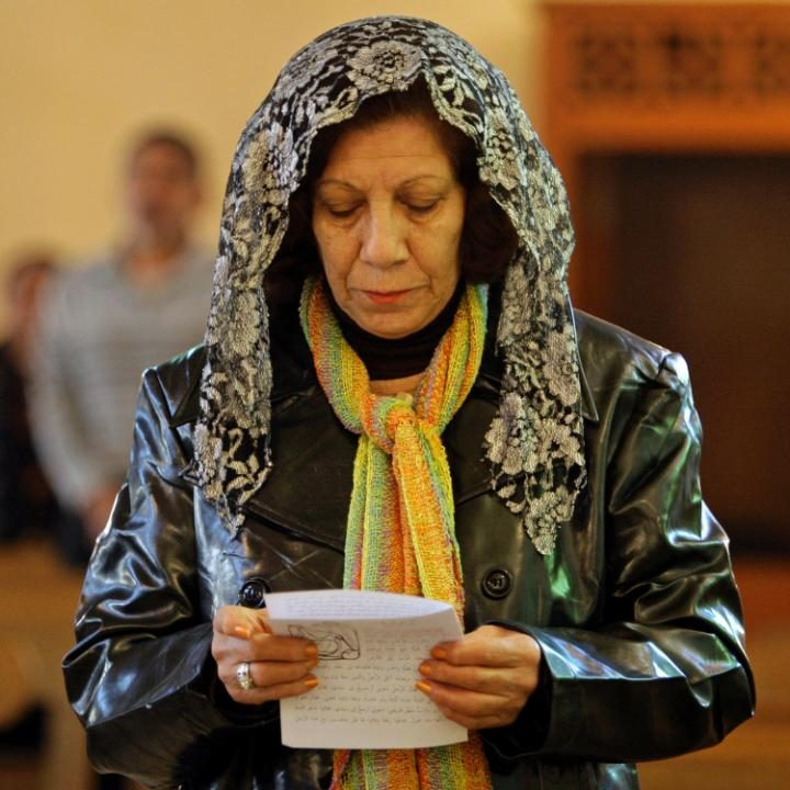 An Iraqi woman worships at the Mar Youssif Chaldean Church in Baghdad in 2009. Many Christians have left the country since then.