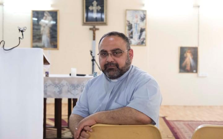 Father Martin Hermis Dawood leads prayers at the Virgin Mary Camp in Baghdad every Saturday