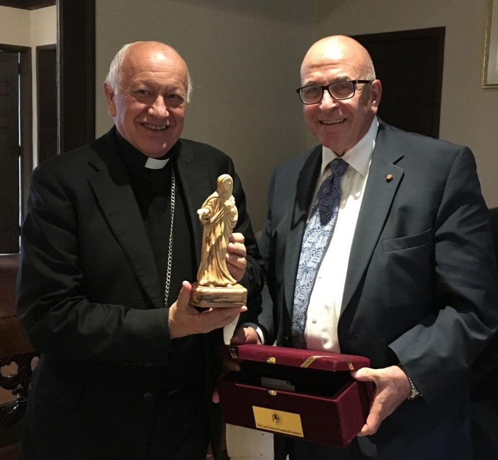 Sir Rateb Rabie gifts an olive wood statue of Our Lady of Palestine hand carved by Christians of the Holy Land to His Eminence Cardinal Ricardo Ezzati Andrello, S.D.B., Archbishop of Santiago.