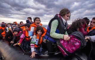 web-refugee-afgan-middle-east-raft-life-jackets-nicolas-economou-shutterstock_367744034