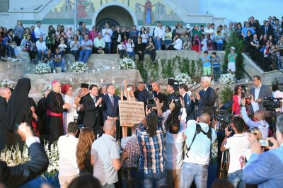 "Crowds gather to commemorate the official recognition of ""Our Lady of Mantara- Maghdouche"" as an international religious tourism destination."