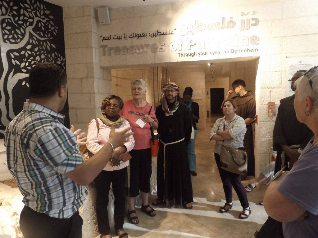Pilgrims see the history of Holy Land through the eyes of the Palestinian Christians.