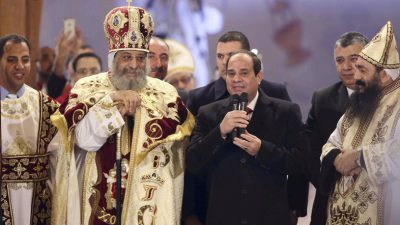 Egyptian President Abdel Fattah al-Sisi (2nd R) talks next to Coptic Pope Tawadros II as he attends Christmas Eve Mass at St. Mark's Cathedral, the seat of the Coptic Orthodox Pope in Cairo, January 6, 2015.  REUTERS/Al Youm Al Saabi Newspaper (EGYPT - Tags: RELIGION POLITICS) EGYPT OUT. NO COMMERCIAL OR EDITORIAL SALES IN EGYPT