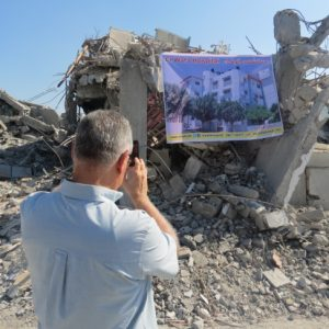 Al-Wafa Rehabilitation Hospital still in ruins with no plans for reconstruction.