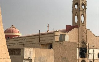 Iraq BArtella 2016 NovemberBartella (Syriac: ܒܪܛܠܐ; Arabic: برطلّة) is an ethnic Assyrian Christian and Shabak town that is located in northern Iraq about 21 kilometres (13 miles) east of Mosul. The name Bartella is of Assyrian Eastern Aramaic origin, but its meaning is not fully agreed on by the historians. While Joseph Ghanima and al-Jawaliqy believe its from Bart Tilla meaning Daughter of Dew, the priest Putros Saba al-Bartelly believes it comes from Beth Rattly meaning House of Weights. The town's residents mostly fled to the Erbil region following the invasion of the town by ISIS in August 2014. Bartella was liberated from ISIS control on 20 October 2016 by Iraqi Special Operations Forces. Early History In northern Iraq the maphrian was the head of church, and reported to the Patriarch in Antioch. In 1859 (or 1860), the Syriac Orthodox Church under Patriarch Yacoub II officially abolished the position of maphrian (Patriarch Yacoub III reinstated the position of maphrian in India in 1964). When Ignatius Elia'azar made Bartella his home and see, dissatisfaction erupted in the community since Mar Mattai Monastery has been the traditional see of the Orthodox maphrian. A compromise was finally reached and he returned to Mar Mattai. However, it was agreed that he would make it a tradition to visit Bartella to emphasize its importance. Other maphrians who made their see in Bartella were Dionysius Saliba II (1222–1231), Gregorius Barsuma (1288–1308), Gregorius Mattai I (1317–1345), Gregorius bar Qeenaya (d. 1361), Athanasius Abraham II (1365–1379), and Cyril Joseph III (1458–1470). The Syriac orthodox Bishop Marotha of Tikrit, who, in 639, was ordained Maphrian of the East. In 1153, Maphrian Ignatius La'azer, Maphrian chose Bartilla as his see. Bartilla was also chosen as the see for Maphrian Dionysius Saliba II in 1223; in 1231 this Maphrian was killed in a battle in the area of Tur Abdin. Bartella gained fame again in 1284 when Maphrian Gregoris bin al-Ebry built the