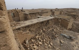 Journalists walk at the damaged ancient site of Nimrud, which was destroyed by the Islamic State militants, southeast of Mosul, Iraq, seen here on November 16, 2016. (AP/Hussein Malla)