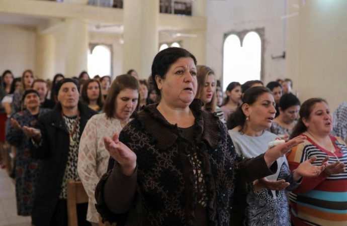 Iraqi Christians who stay are pillars of the local community