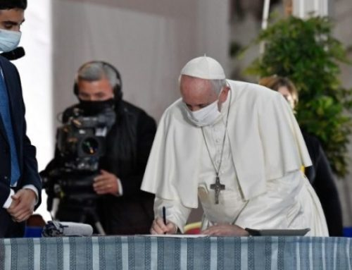Pope signs an appeal for peace at the International Prayer Meeting for Peace in Rome.